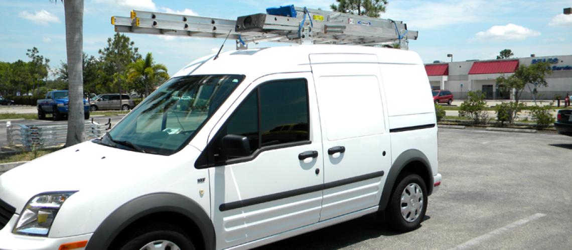 Transit van with ladders on top
